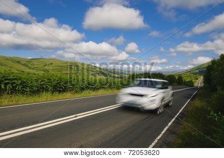 Speeding Car On Scottish Road