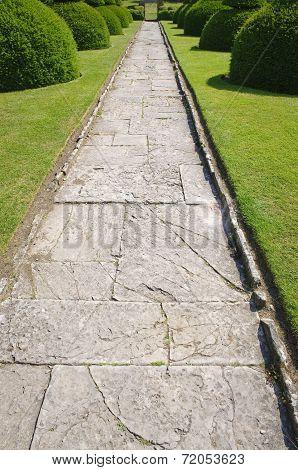 Stone Alley In English Formal Garden