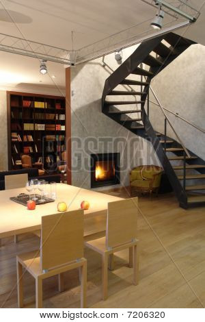 interior of a living room with fireplace and stair  interior of a living room with fireplace and sta