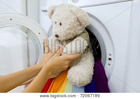 Delicate Wash: Woman Taking Fluffy Toy From Washing Machine