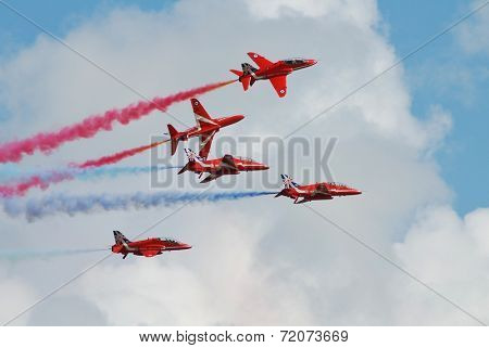 EASTBOURNE, ENGLAND - AUGUST 14, 2014: RAF aerobatic display team The Red Arrows perform at the annual Airbourne airshow. The team were first formed in 1965.