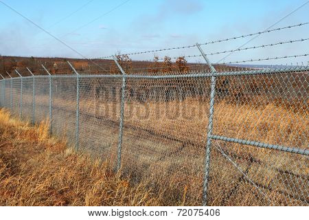 Field with a large wire fence