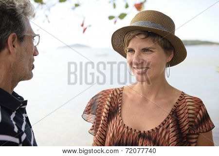 Middle aged couple talking on vacation