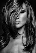 Black and white photo of seductive woman with closed eyes, stylish makeup and hairstyle, luxury photoshoot of super model poster
