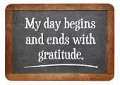 My day begins and ends with gratitude - positive affirmation words on a vintage slate blackboard poster
