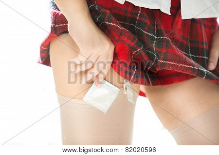 Sexy Woman In School Uniform Putting Condom Under Stocking
