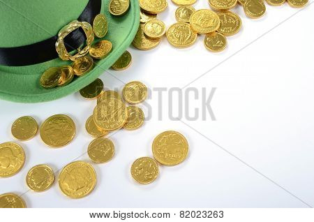 Happy St Patricks Day Leprechaun Hat Gold Chocolate Coins On White Table.