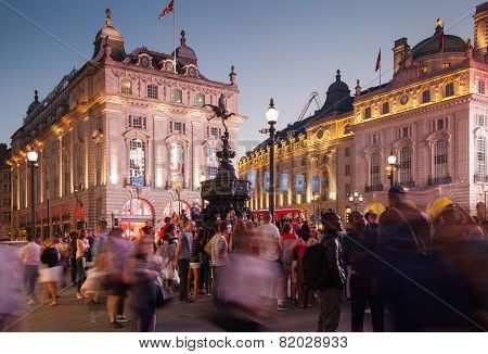 LONDON, UK - AUGUST 22, 2014: Piccadilly Circus in night. Famous place for romantic dates. Square w