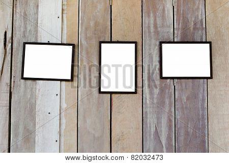 Three Blank Frame On Wood Wall