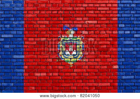 Flag Of Quito Painted On Brick Wall
