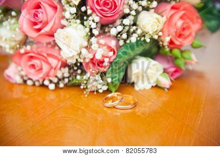 Wedding Rings On A Background Of A Wedding Bouquet Bride