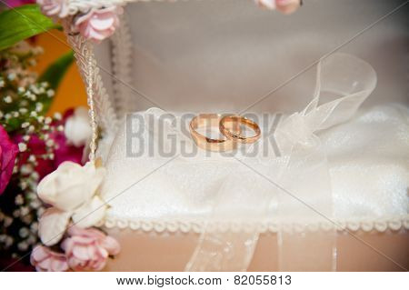 wedding rings lie in the white trunk for rings