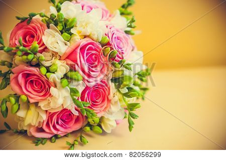Two Rings Lie On A Bouquet