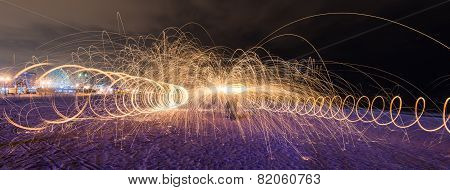 Showers of hot glowing sparks from spinning steel wool at Coney Island Beach Brooklyn New York. poster