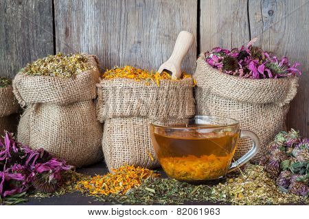 Healing Herbs In Hessian Bags And Healthy Tea Cup, Herbal Medicine.