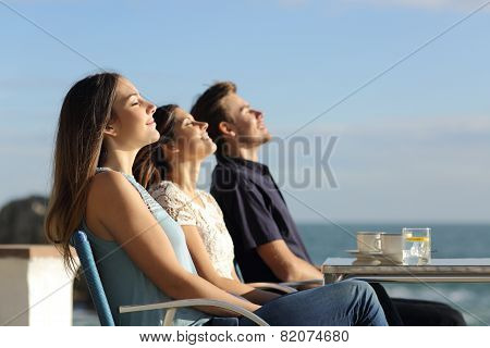 Group Of Friends Breathing Fresh Air In A Restaurant On The Beach
