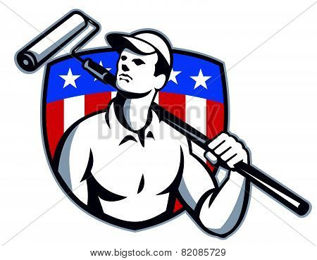 Illustration of a handyman tradesman carpenter painter carrying a paint roller looking up with American stars and stripes flag shield in the background done in retro style. poster