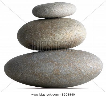 Three Pebbles Balancing On Each Other On A White Background
