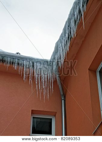 Icicles Series On The Roof Of The House When The Warming.