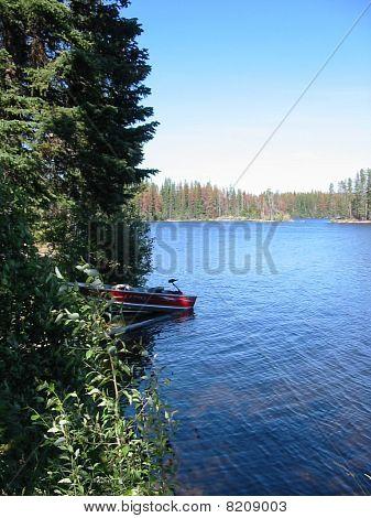 boat snuggled up to edge lake