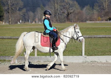 Young Girl Is Riding