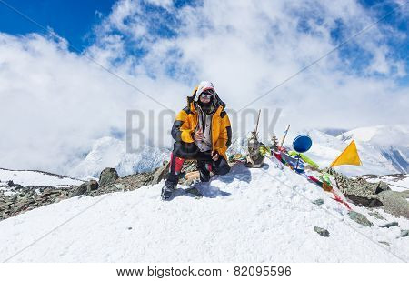 Mountain climber at the top of Lenin Peak Pamir Mountains Kyrgyzstan
