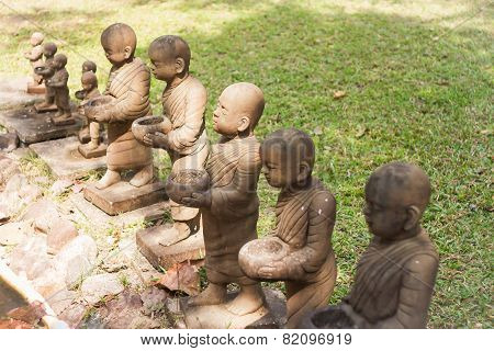 Little Monk Clay Doll Decorated In Garden