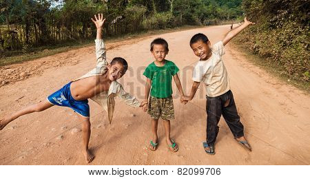 Unidentified kids posing on a road in Vang Vieng Laos