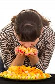 young hungry brunette girl overeating junk food poster