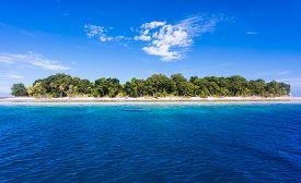 Blue ocean water and Idyllic tropical island of Sipadan in Sabah Malaysia.
