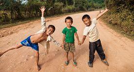 Unidentified kids posing on a road in Vang Vieng Laos