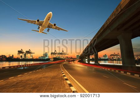 Road ,land Bridge Run Into Ship Port And Commercial Cargo Plane Flying Above Use For Land ,air And V