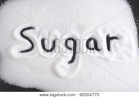 Word Written With Finger On Pile Of Sugar In Diet , Sweet Overuse And Healthy Nutrition Concept Isol