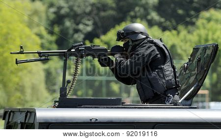 special force unit assault team attacks with heavy machine gun poster
