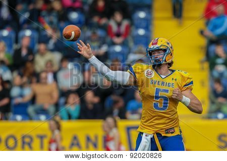 ST. POELTEN, AUSTRIA - JUNE 1, 2014: QB Anders Hermodsson (#5 Sweden) passes the ball.