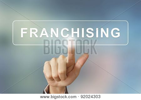 Business Hand Clicking Franchising Button On Blurred Background