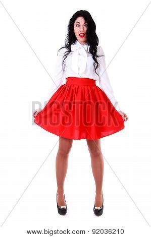 Beautiful young woman in a white blouse and a red skirt isolated over white background poster