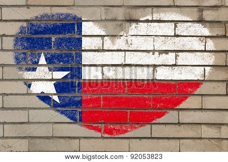 Heart Shape Flag Of Texas On Brick Wall