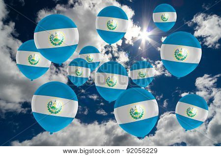Many Balloons With El Salvador Flag On Sky