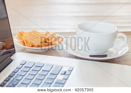 Laptop With Coffee Cup And Snack