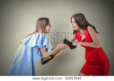 Girls fighting for a pair of shoes