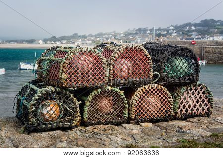 Lobster Pots Or Traps On Harbour Wall In England