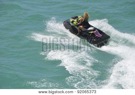 Blond Riding on a Black Jet Ski