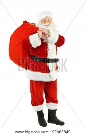 Santa Claus with bag, filled gift boxes isolated on white background