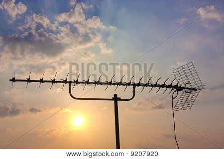 TV antenna on sky background