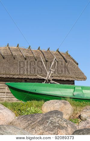 Fisherman Rowboat And Old Rustic Utility House