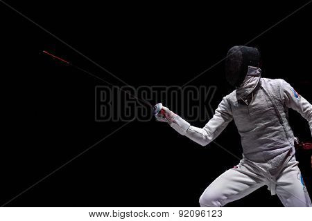 ST. PETERSBURG, RUSSIA - MAY 3, 2015: Artur Akhmatkhuzin of Russia in the team final match of 41th International fencing tournament St. Petersburg Foil. The tournament is the stage of FIE World Cup