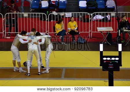 ST. PETERSBURG, RUSSIA - MAY 3, 2015: US team prepares for the match against Germany during 41th International fencing tournament St. Petersburg Foil. The tournament is the stage of FIE World Cup
