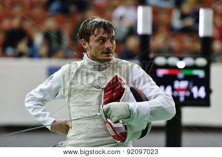 ST. PETERSBURG, RUSSIA - MAY 2, 2015: Dmitry Rigin of Russia in 1/16 final of 41th International fencing tournament St. Petersburg Foil. The tournament is the stage of FIE World Cup