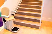 An Electric Powered Assistance Stair Lift with Seat. poster